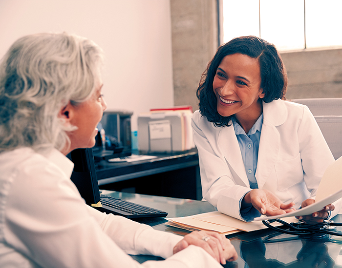 female doctor consulting patient